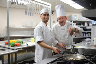 Chef and student preparing to cook