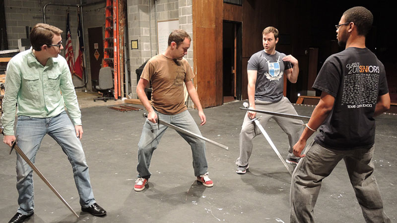 Students at a stage combat workshop
