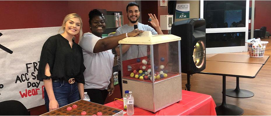 Picture of Student Activities staff during Grocery Bingo game