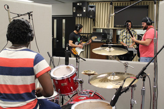 Music band practice in studio hall